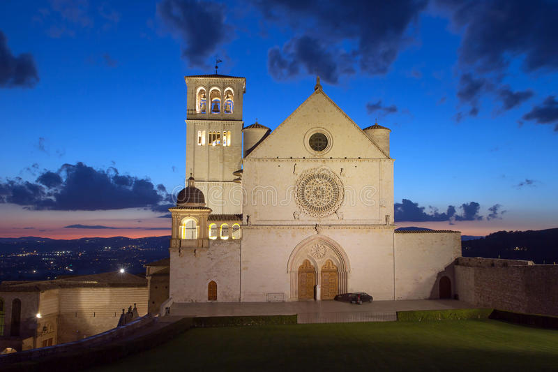 The Papal Basilica of St. Francis of Assisi at sunset (Assisi, U royalty free stock photography