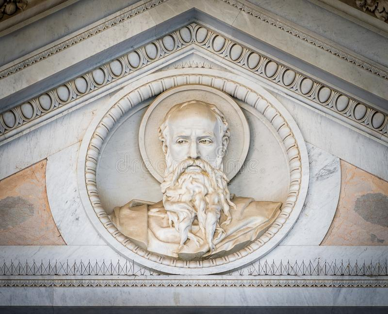 Bas relief of Saint Paul head over the main gate of the Basilica of Saint Paul Outside the Walls. Rome, Italy. The Papal Basilica of St. Paul Outside the Walls stock photography