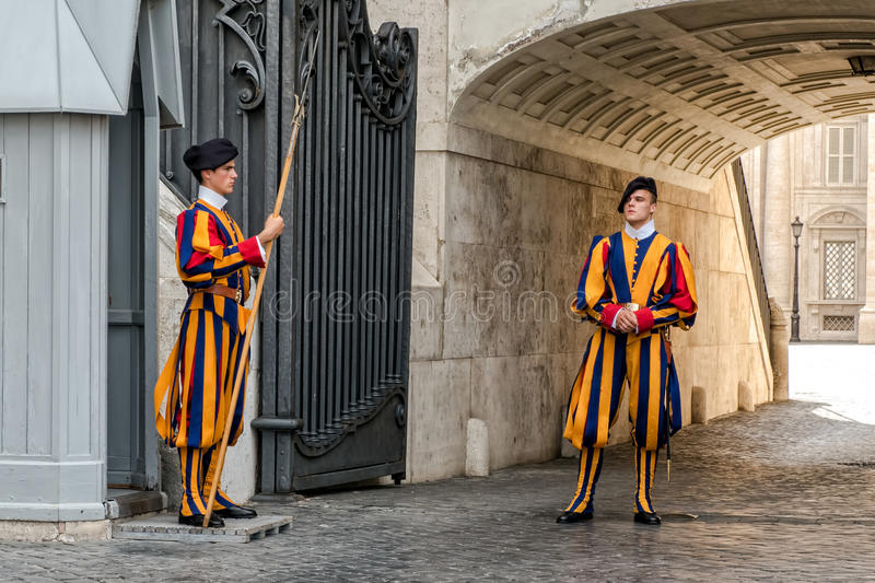 Papal Swiss Guards. Swiss Guards in dress uniform at St. Peter`s Basilica, Vatican City royalty free stock image