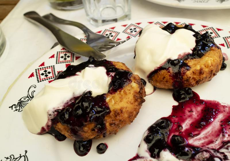 Papanasi, a Traditional Romanian Dessert stock photo