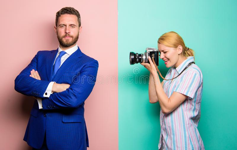 Paparazzi concept. Handsome businessman posing camera. Nice shot. Fame and success. Photographer taking photo successful royalty free stock photo