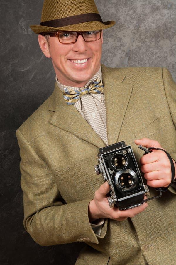 Paparazzifotograf med tappningkameran arkivfoto
