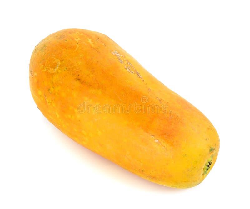 Papaya amarilla aislada en el fondo blanco imagen de archivo libre de regalías