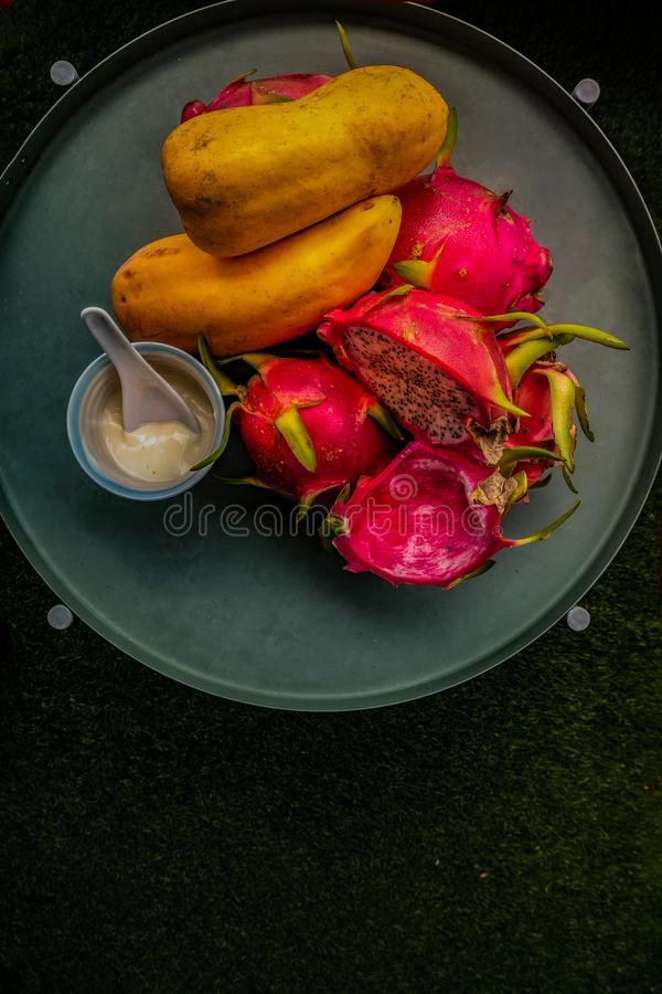 Papaya, dragon fruit and yoghurt helps maintain a healthy bowel movement for its healthy enzymes. Copy space royalty free stock image