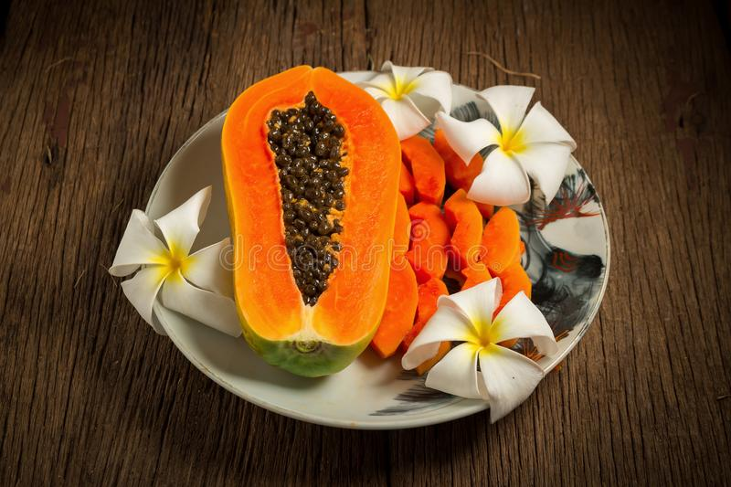 papaya fresh fruit. on dish. on old wooden. morning. sunset beau stock photography
