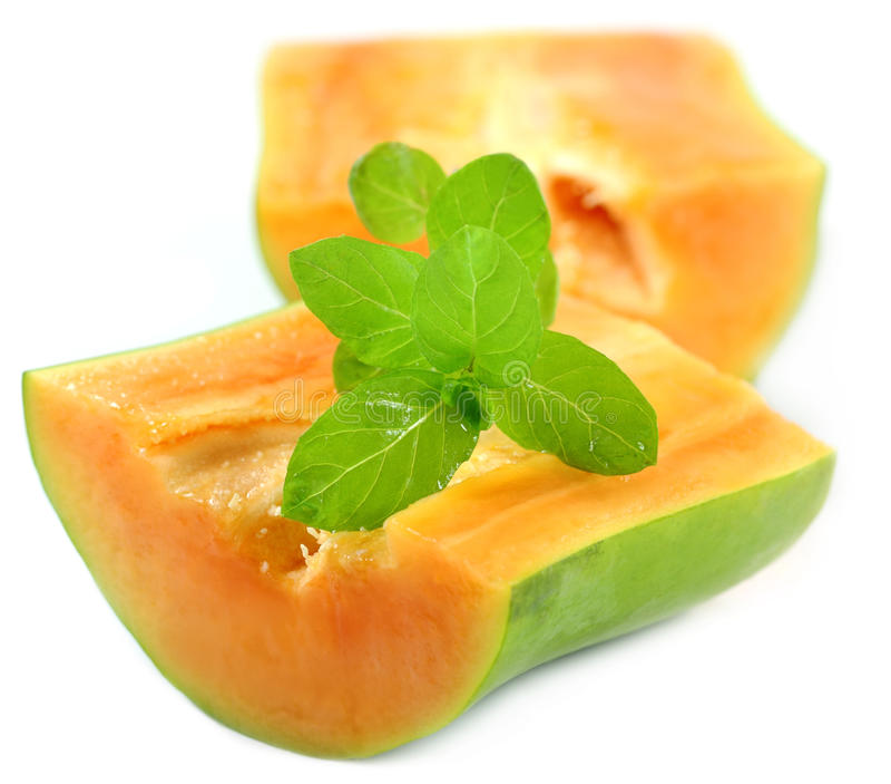 Papaya with fresh mint leaves