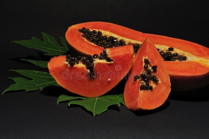Papaya fruit isolated on black background stock photo