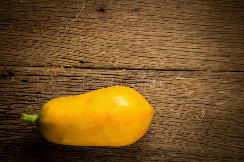 papaya fruit. old wooden. moring. sunset. art. asian. top view stock image