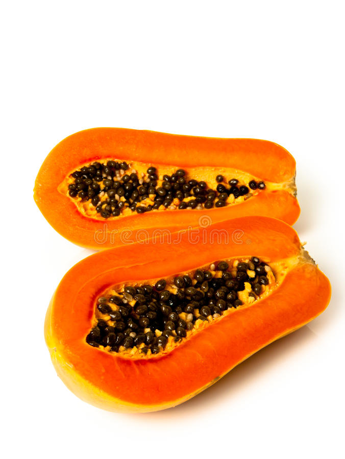 Papaya fruit sliced on half. Over white background royalty free stock photos