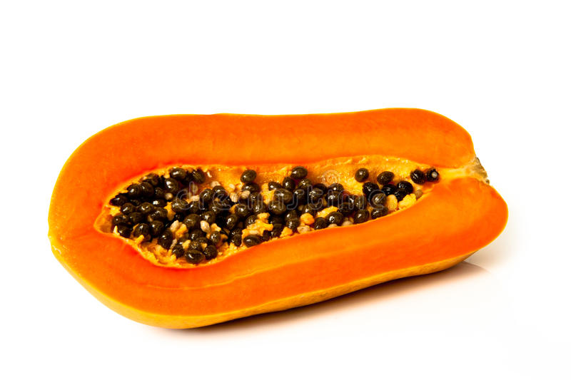 Papaya fruit sliced on half. Over white background royalty free stock photo