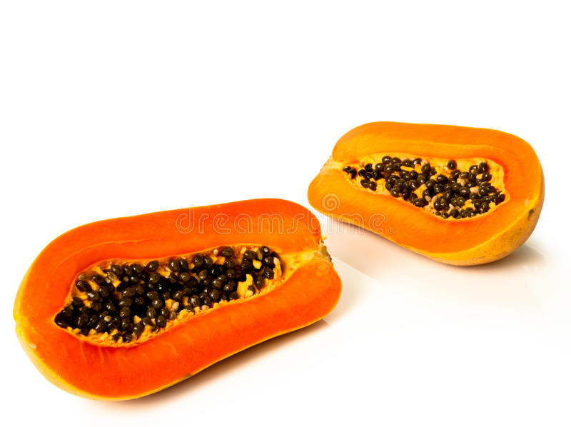 Papaya fruit sliced on half. Over white background stock images