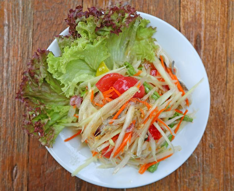 Papaya salad with crab in white plate on wood table stock image