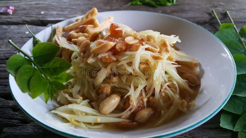Papaya salad dour spicy. Thai style papaya salad spicy sour royalty free stock photo