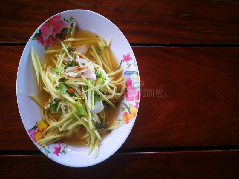 papaya salad for fish fried stock images