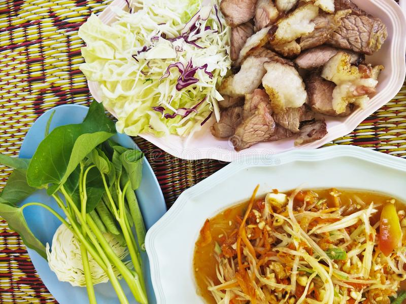 Papaya salad and grilled meat. Thai food is a type of food that was first made in Thailand. Thai food is often spicy, but does not have to be.Thai food is shared stock image