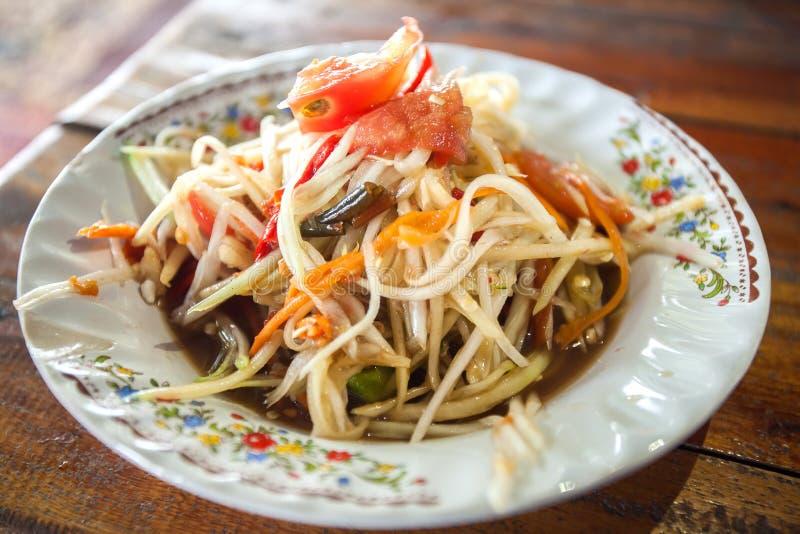 Papaya salad hot spicy Som Tam on a plate thailand. stock image