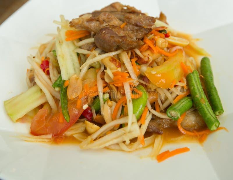 Papaya salad roasted pork. Closeup royalty free stock photo