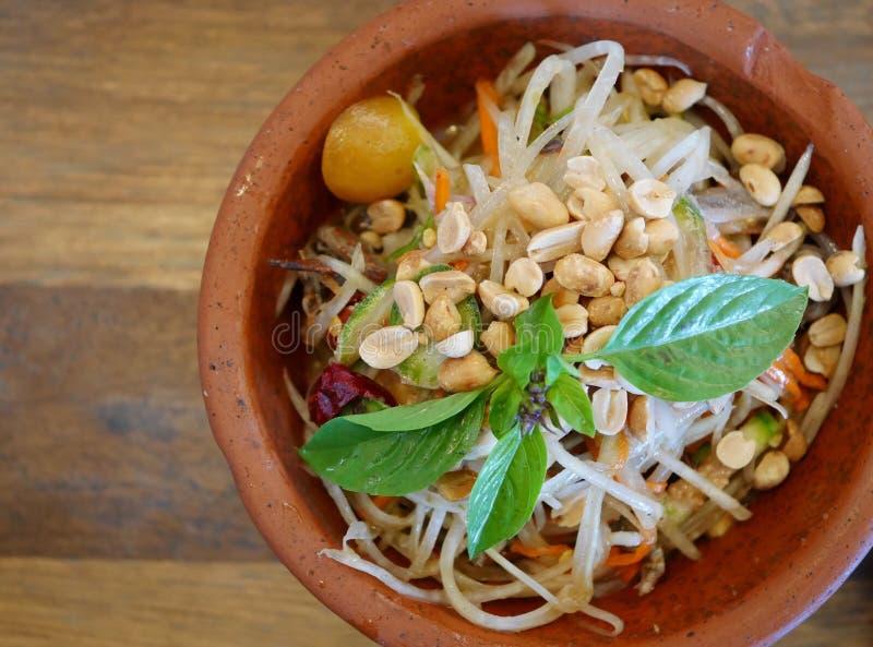 Papaya Salad (Som Tum) on wooden table royalty free stock images