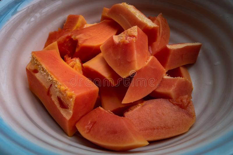 Papaya sliced Great tropical fruit that helps maintain a healthy bowel movement for its healthy enzymes. Oblique view from the top stock photography