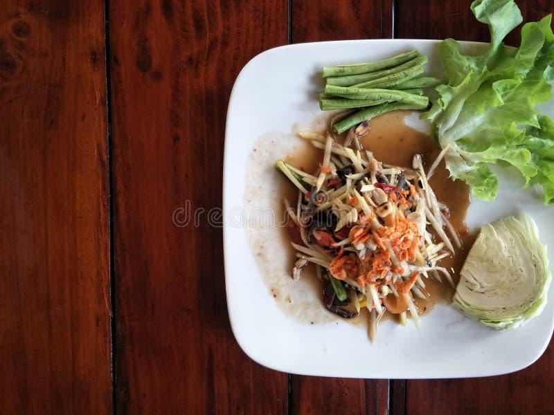 Papaya spicy salad or Som Tum.Thai-Esan food stock photo