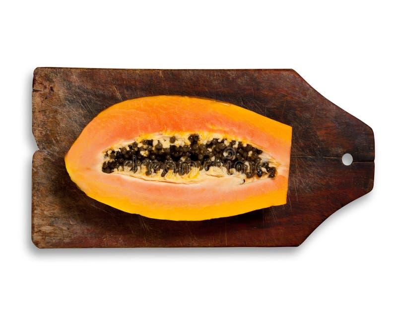Papaye fraîche coupée en tranches sur le fond en bois photos libres de droits