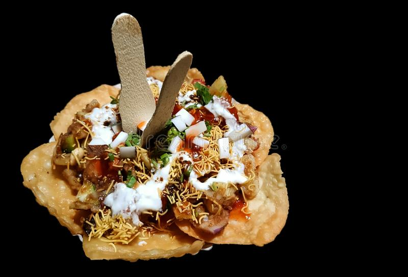 Papdi chaat indian spicy snack isolated in black background royalty free stock images