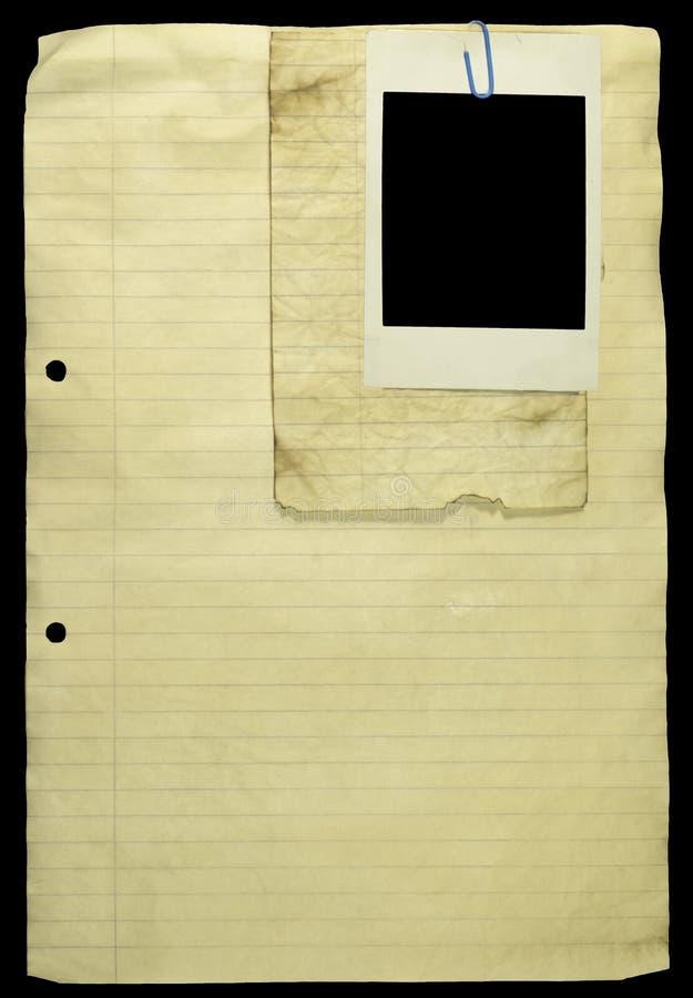 Papel alineado viejo con el clip de papel y una polaroid. fotografía de archivo