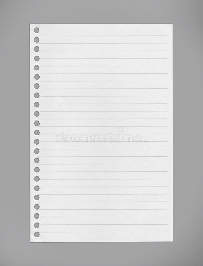 Papel alinhado do caderno em trajetos cinzentos do fundo/grampeamento imagens de stock