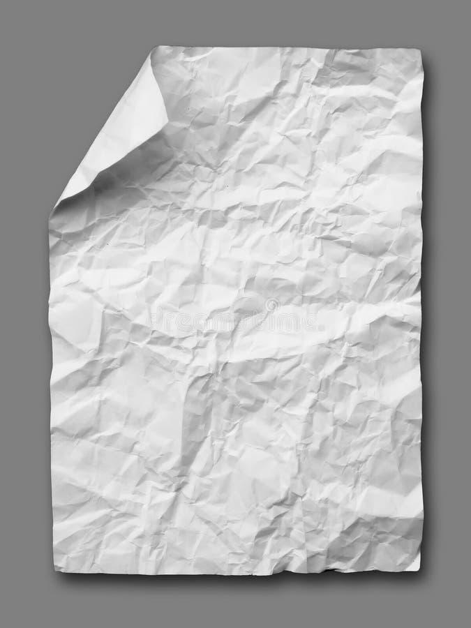Papel amarrotado branco no cinza imagem de stock