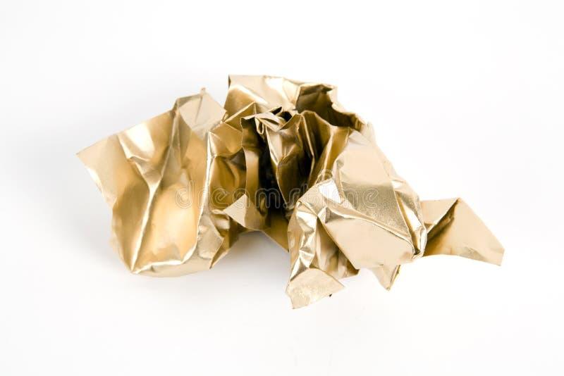 Papel arrugado oro imagen de archivo