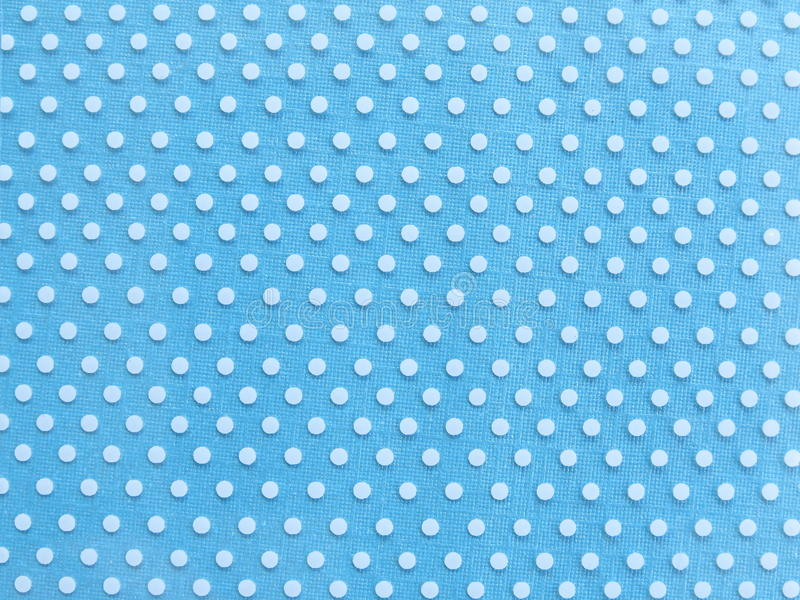 Papel azul claro con la textura blanca del modelo de punto foto de archivo