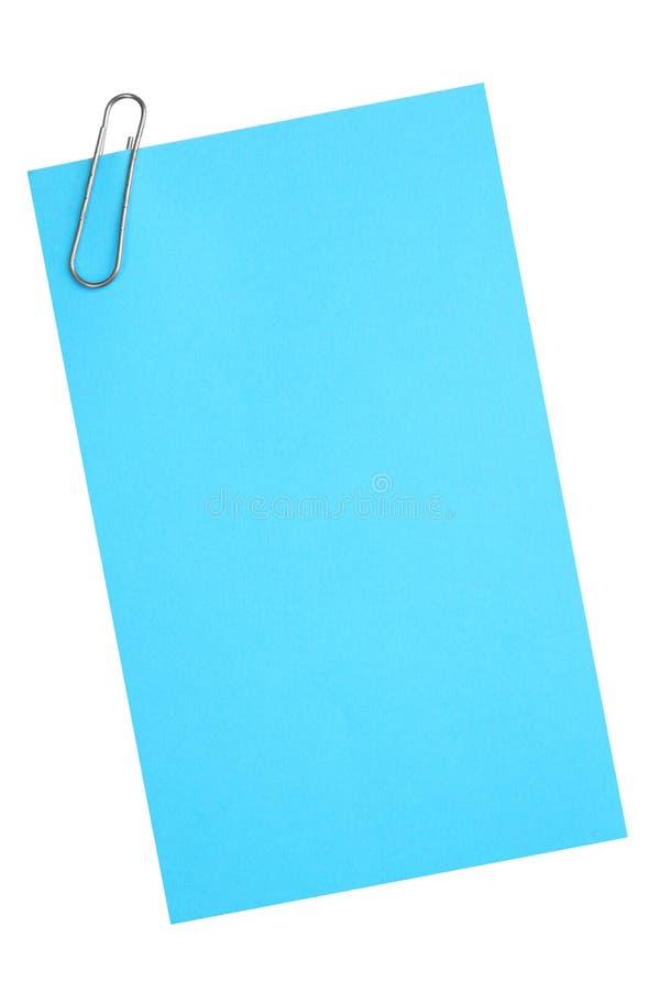 Papel azul en blanco con el clip imagen de archivo libre de regalías