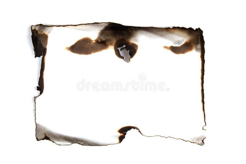 Papel chamuscado aislado foto de archivo