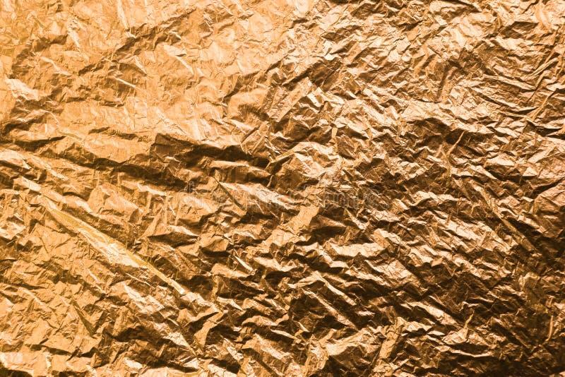 Papel coloreado amarillo arrugado Fondo Textured oro fotos de archivo