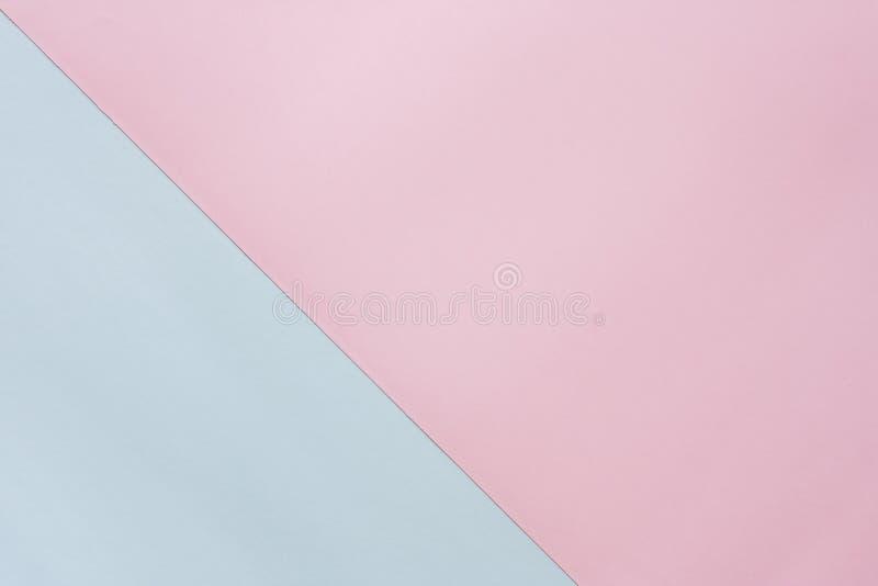 Papel coloreado en colores pastel del azul y del rosa imágenes de archivo libres de regalías