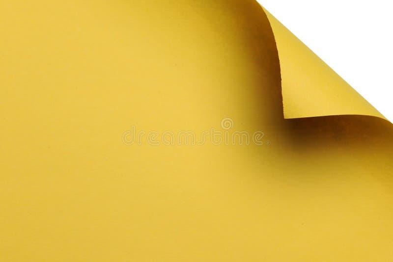 Papel com canto curvado de encontro a um fundo branco fotografia de stock