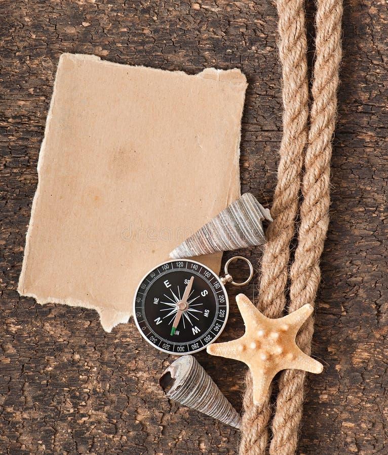 Papel, compasso, corda e concha do mar foto de stock royalty free