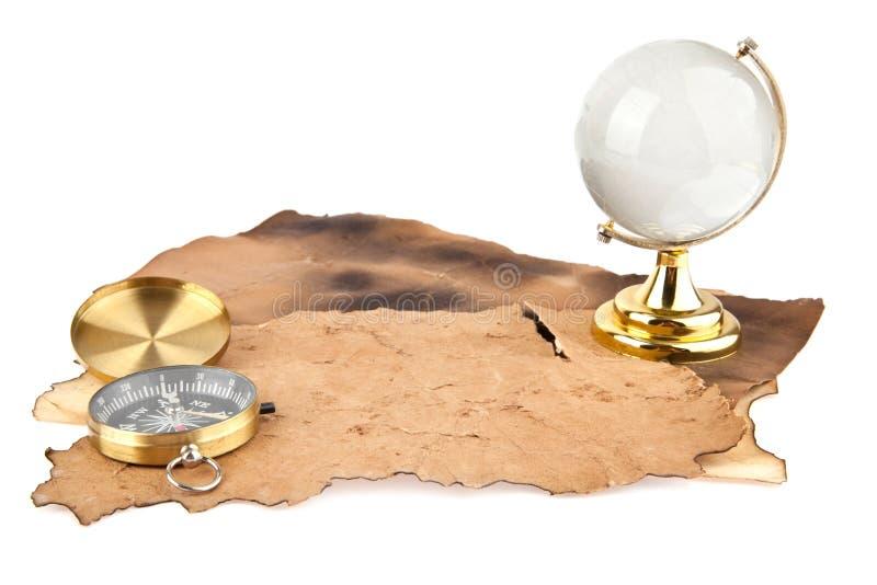 Papel, compasso e globo velhos imagens de stock royalty free