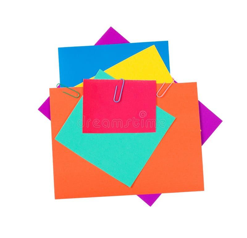 Papel da cor com um grampo de papel fotografia de stock royalty free