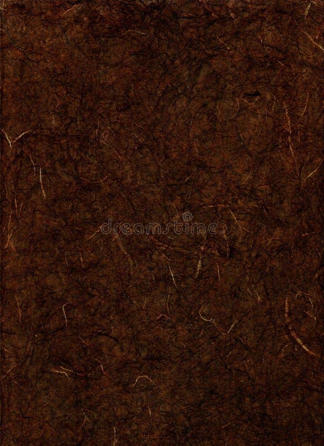 Papel da textura de Brown escuro fotos de stock royalty free