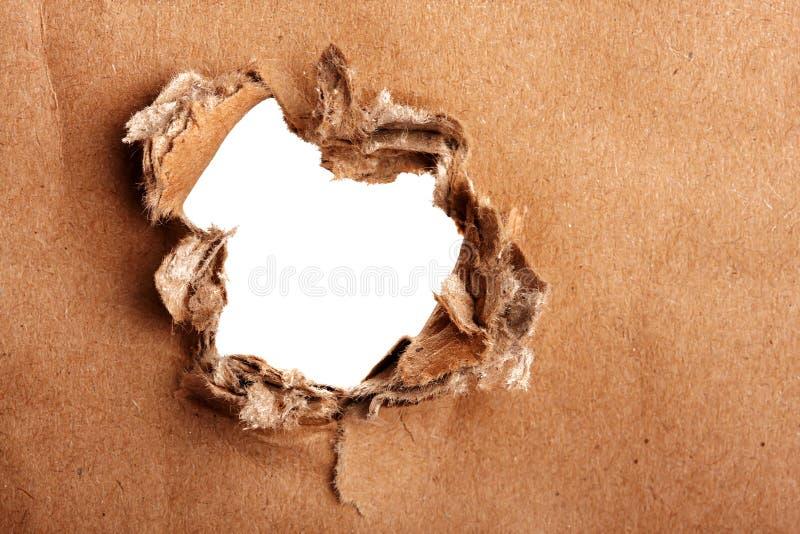 Papel de Brown com furo imagens de stock royalty free