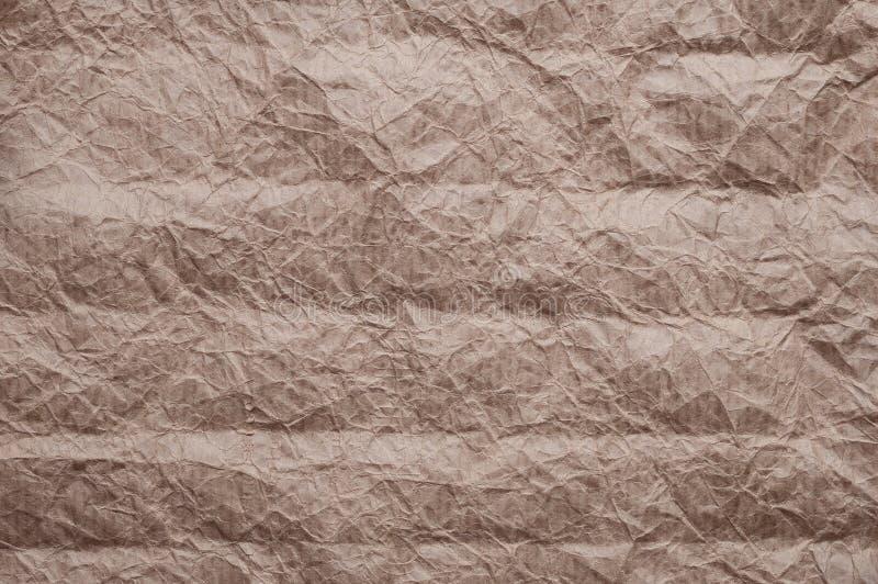 Papel de embalagem Amarrotado A textura amarrotou o papel marrom velho reciclado imagens de stock