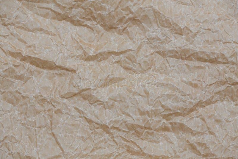 papel de embalagem enrugado Textura de papel amarrotada marrom do fundo da vista superior fotografia de stock royalty free