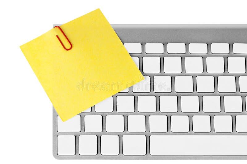 Papel de la nota con el teclado foto de archivo libre de regalías
