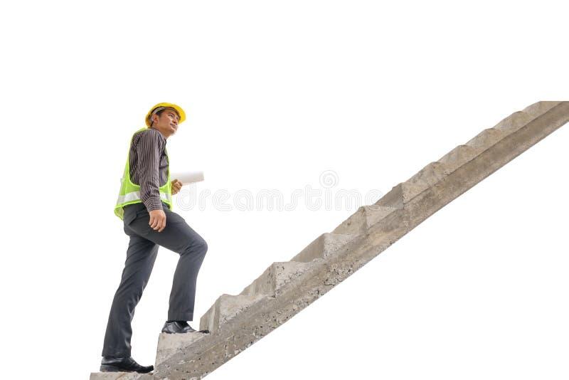 Papel de modelo asiático del control del ingeniero de construcción del hombre de negocios fotografía de archivo