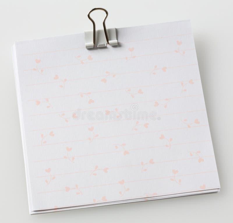 Papel de nota com grampo de papel imagens de stock royalty free