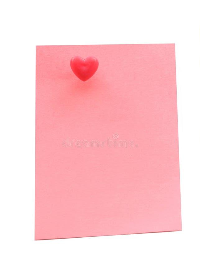 Papel de nota com pushpin do coração fotografia de stock