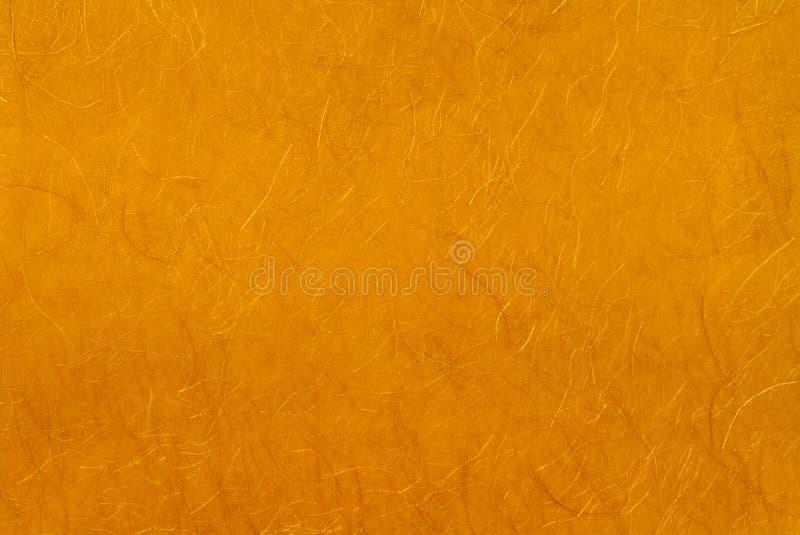 Papel de oro con la cuerda de rosca del oro. foto de archivo libre de regalías