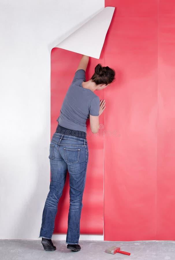 Papel de parede de suspensão da mulher fotografia de stock