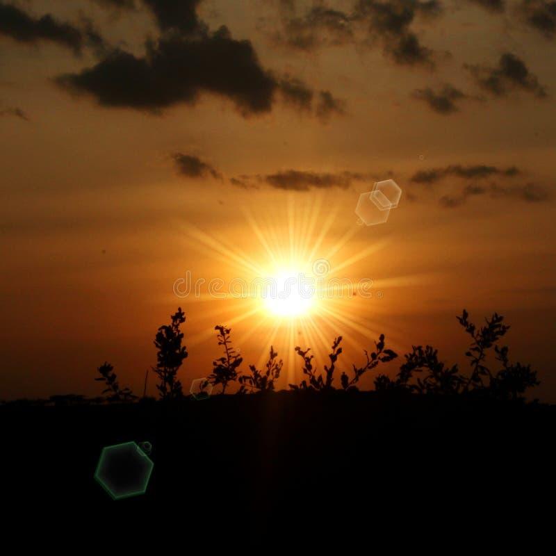 Papel de parede do fundo da imagem da paisagem do por do sol fotos de stock